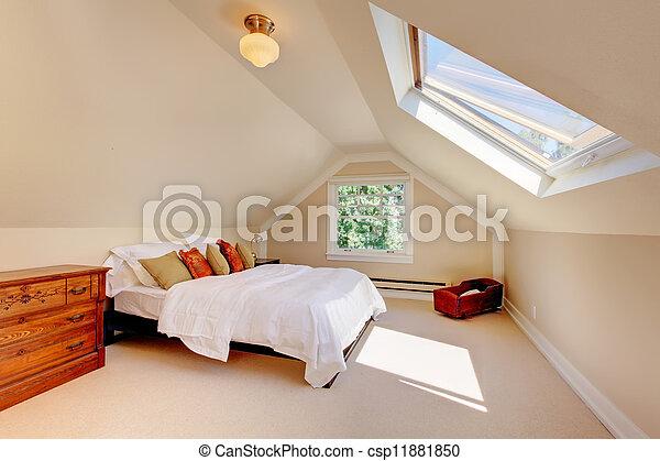 Un dormitorio moderno con cama blanca y claraboya. - csp11881850