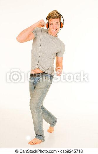 écouteurs, jeune homme, danse - csp9245713