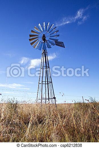 éolienne, ciel bleu, soleil levant - csp6212838