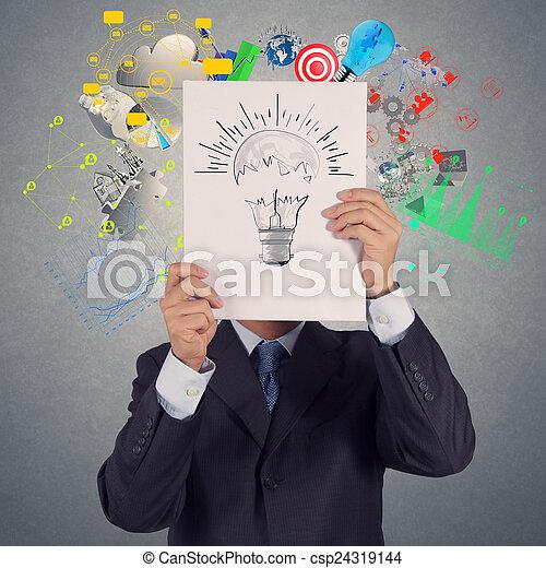 El empresario muestra bombilla en el libro de éxitos de portada - csp24319144