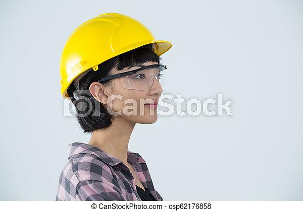 σκληρά , φόντο , εναντίον , κουραστικός , γυναίκα , γυαλιά , ασφάλεια , αγαθός καπέλο , αρχιτέκτονας  - csp62176858