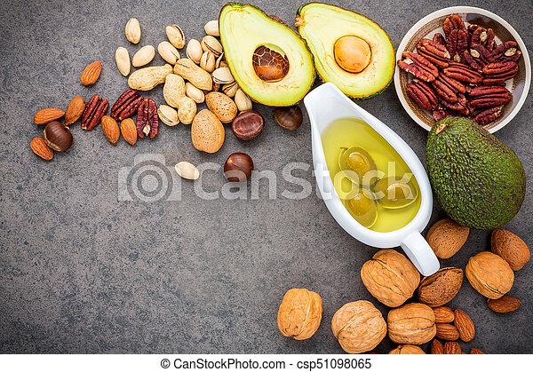 アーモンド, e, 食品。, バックグラウンド。, 選択, 3, ヘイゼルナッツ, 源, 繊維, オリーブ, ビタミン, 鮭, fats., クルミ, superfood, 健康, 食事である, オイル, 食物, 石, オメガ, fish, 高く, 不飽和, オイル - csp51098065