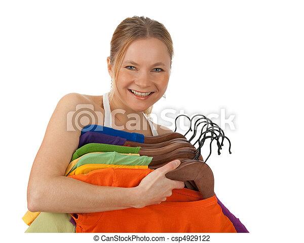 女, 若い, 魅了, 保有物, カラフルである, 衣服 - csp4929122