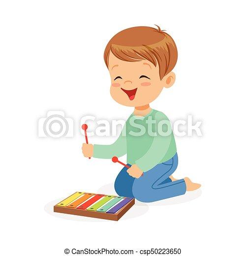 木琴 かわいい わずかしか おもちゃ 子供 男の子 音楽家 若い