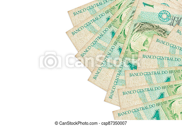1 Brazilian real bills lies isolated on white background with copy space. Rich life conceptual background - csp87350007