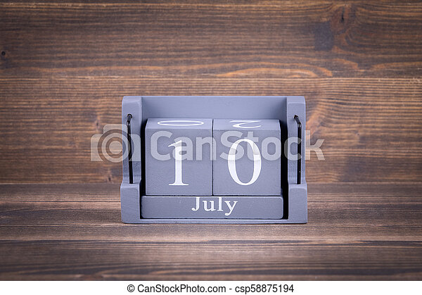 10 July. Wooden, square calendar - csp58875194