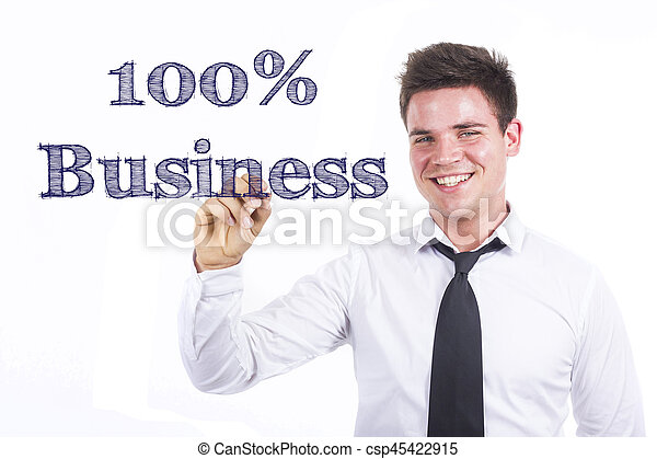 100% Business - Young smiling businessman writing on transparent surface - csp45422915