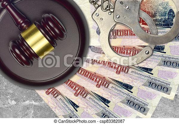 1000, impôt, action éviter, procès, desk., marteau, tribunal, police, cambodgien, juge, judiciaire, menottes, factures, concept, ou, riels, bribery. - csp83382087