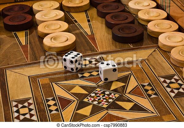 2 dice on the backgammon desk - csp7990883