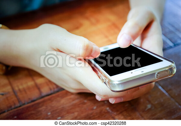 2 Hands holding mobile smart phone with blank screen. - csp42320288