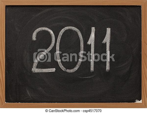 2011 - white chalk on blackboard - csp4517070