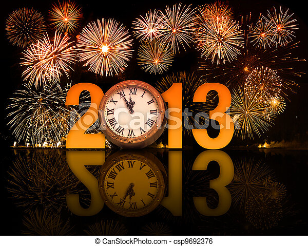 2013 year with fireworks and clock displaying 5 minutes before midnight - csp9692376