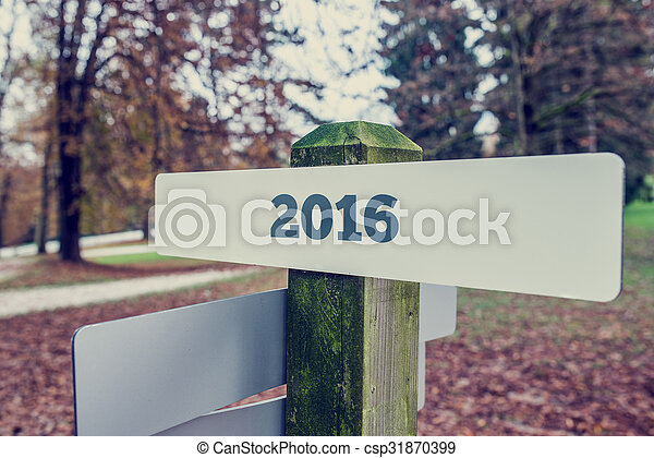 2016 sign on a wooden signboard - csp31870399