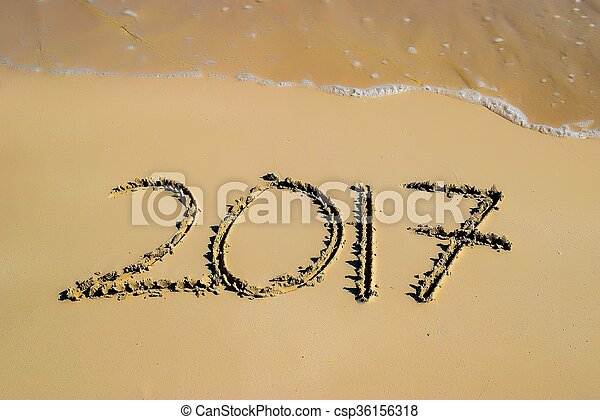 2017 written in sand, on tropical beach - csp36156318