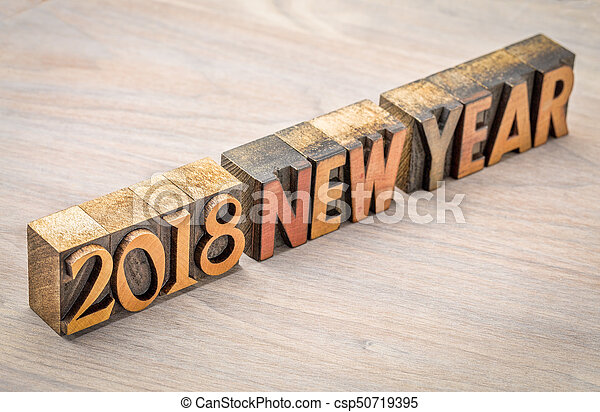 2018 New Year in vintage wood type - csp50719395