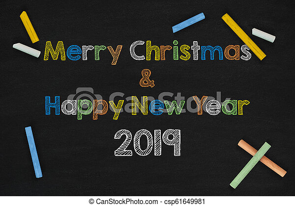 2019 and Merry Christmas Word On Chalkboard - csp61649981