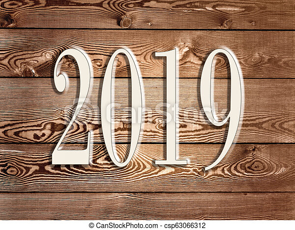 2019 new year on a wooden panel - csp63066312