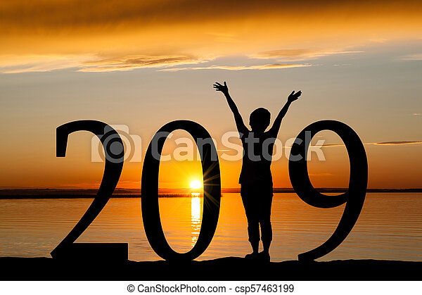 2019 New Year Silhouette of Woman at Golden Sunset - csp57463199