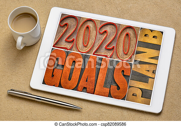 2020 goals plan B - word abstract in wood type - csp82089586
