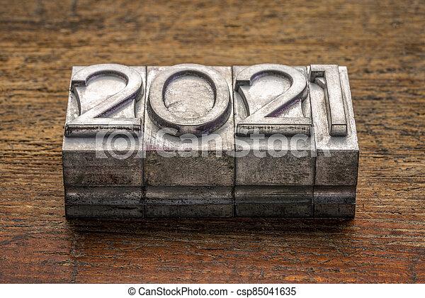 2021 year in vintage, gritty letterpress metal type - csp85041635