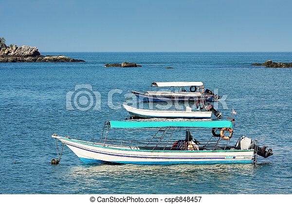 3 boat on blue lagoon - csp6848457