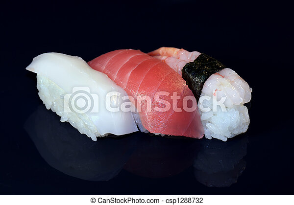 3 Pieces Of Sushi Squid Tuna And Raw Shrimp Sushi On A Black