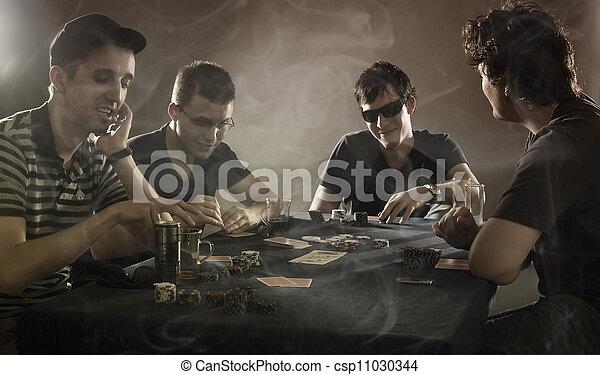 4 guys playing poker - csp11030344