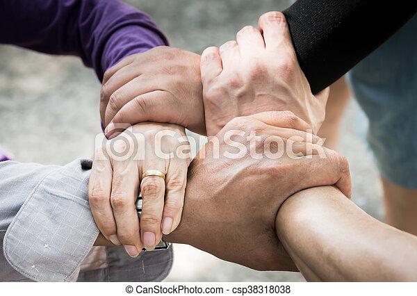 4 hand Assemble Corporate Meeting /Teamwork - csp38318038
