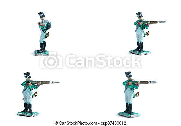 4 in 1 photo of handmade tin soldiers with musket on the white background - csp87400012