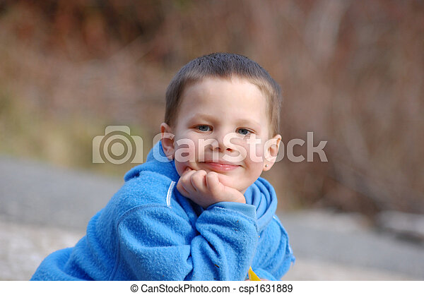 4 year old boy happy and content 4 year old child is happy and