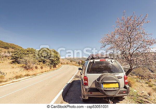 4x4 car on road side in mountains - csp53051031
