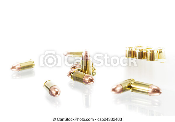 9 mm. bullets on white background - csp24332483