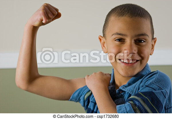 9 Year Old Multi Racial Boy Showing Off His Muscles - csp1732680