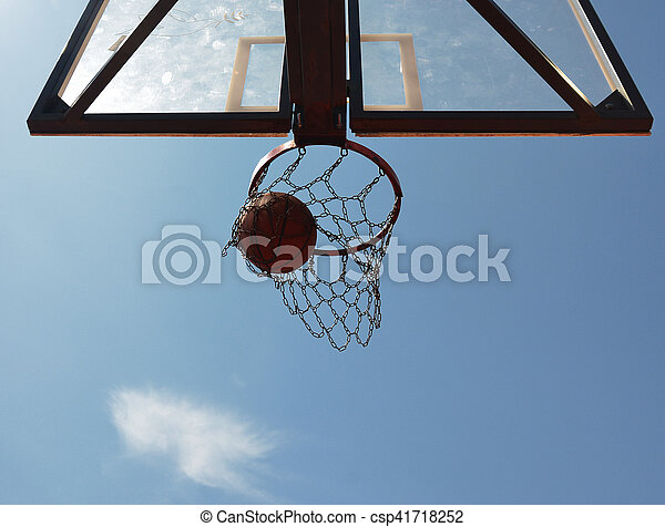 A basketball swishes through the hoop - csp41718252
