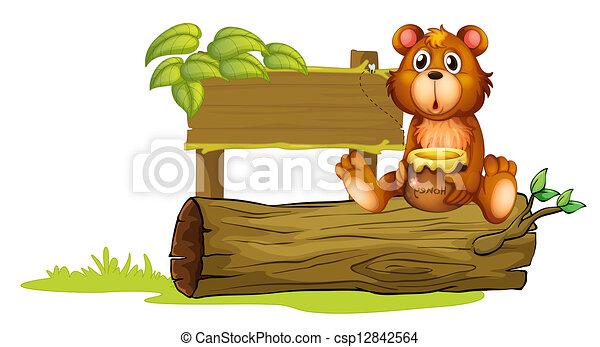 A bear sitting on a trunk - csp12842564