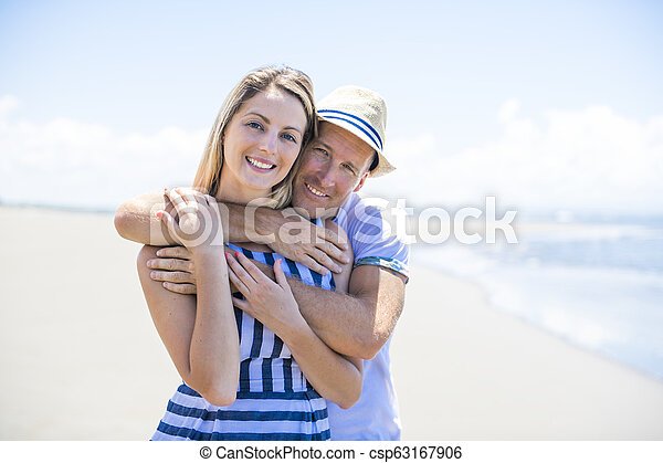 A beautiful and happy couple having fun at the beach of Costa Rica - csp63167906