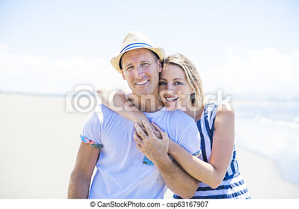 A beautiful and happy couple having fun at the beach of Costa Rica - csp63167907