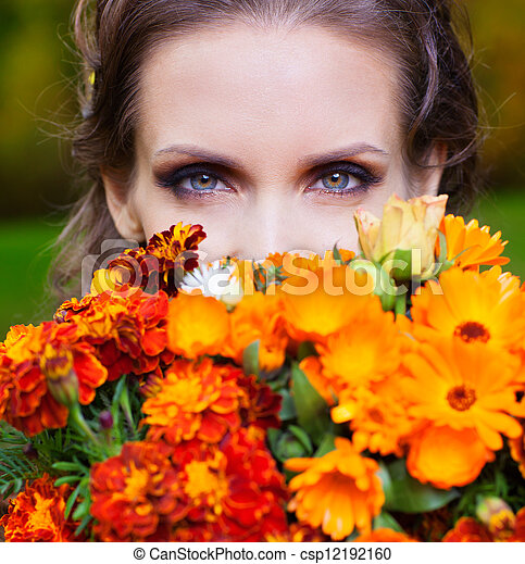A beautiful brunette with flowers - csp12192160