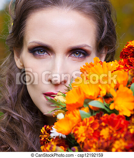 A beautiful brunette with flowers - csp12192159