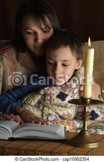 A beautiful Caucasian mother with her son sitting - csp10952354