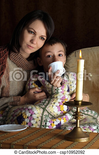 A beautiful Caucasian mother with her son sitting - csp10952092