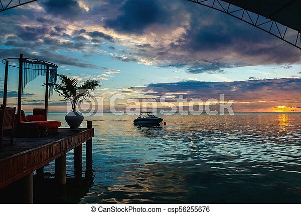 A beautiful colorful sunset over the ocean - csp56255676