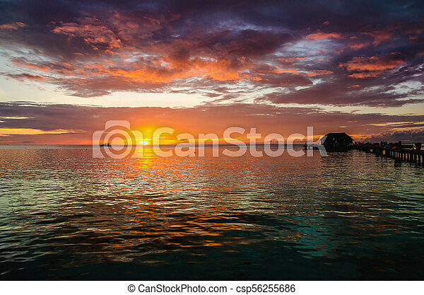 A beautiful colorful sunset over the ocean, Maldives - csp56255686
