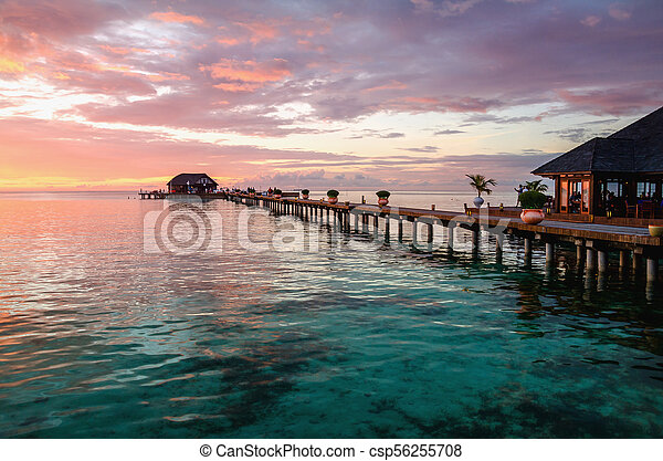A beautiful colorful sunset over the ocean, Maldives - csp56255708