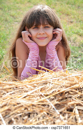 A beautiful dark-haired girl in a field - csp7371651