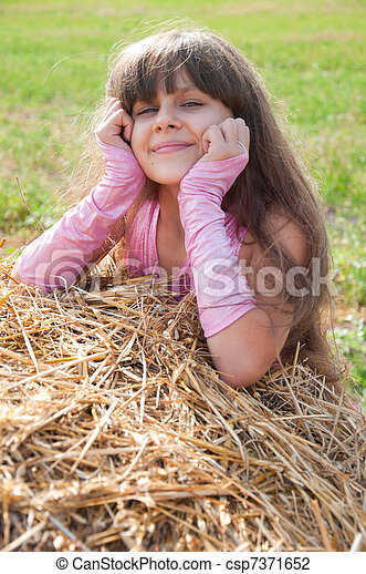 A beautiful dark-haired girl in a field - csp7371652