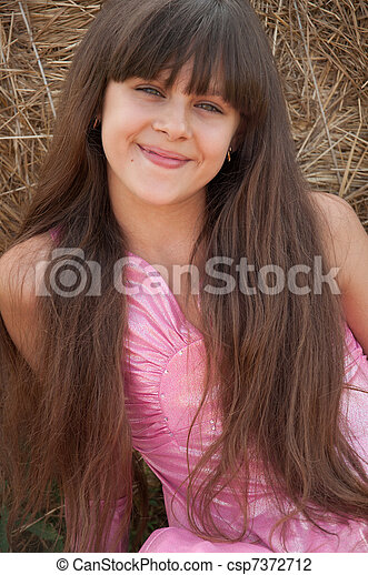 A beautiful dark-haired girl in a field - csp7372712