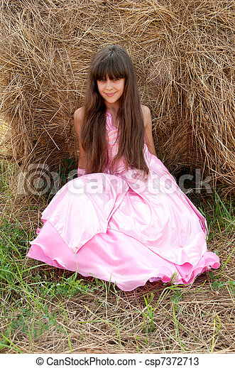 A beautiful dark-haired girl in a field - csp7372713