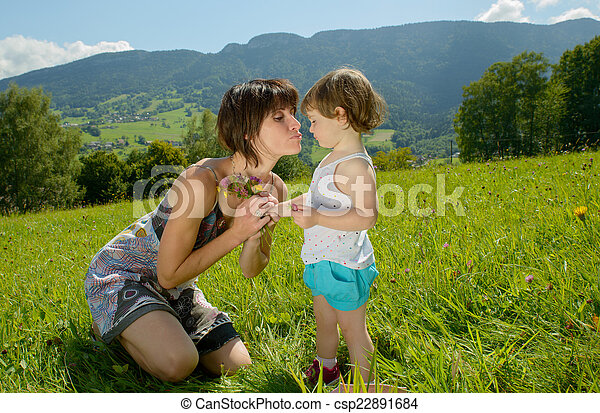 a beautiful mom is a hug to her daughter - csp22891684
