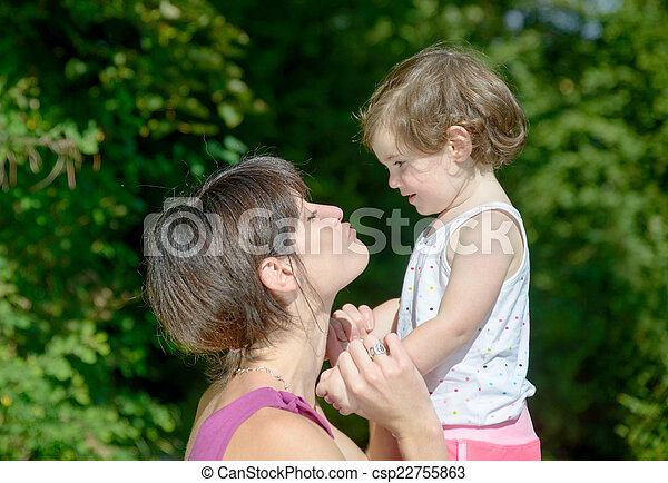 a beautiful mom is a hug to her daughter in nature - csp22755863